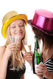 Two casual young women enjoying champagne Stock Images