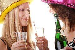 Two casual young women enjoying champagne Stock Image