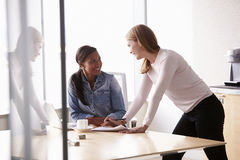 Two Casually Dressed Businesswomen Working In Office Stock Photos