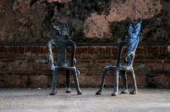 Two Cat Chairs. Two empty iron chairs in Old San Juan, Puerto Rico Royalty Free Stock Photography