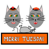 Two cat faces with caps smiling, looking at the lying mouse, with inscription merry tuesday Stock Photo