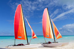 Two catamarans with its colorful sails wide open Stock Images