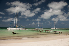 Two catamarans in port of Cayo Blanco, Cuba Stock Photos