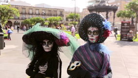Two catrinas pose for day of the dead. Two catrinas pose for day stock video