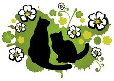 Two cats. With flower silhouettes on a green background Royalty Free Stock Image