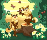 Two cats in the forest is admired by the butterflies. Two cats in the forest is admire by the beautiful view Stock Photography