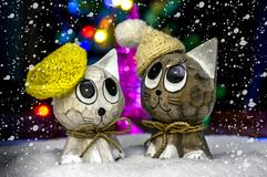 Two cats in hats in the snow. Royalty Free Stock Photos