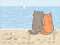 Two Cats Looking At The Sea Royalty Free Stock Photos