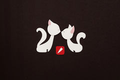 Two cats with red heart applique. Two loved cats applique on texture background Stock Photo