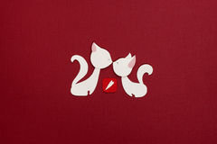 Two cats with red heart applique. Two loved cats applique on texture background Royalty Free Stock Photography