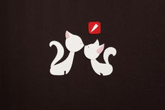 Two cats with red heart applique. Two paper cats applique on texture background Stock Photo