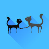 Two Cats Silhouettes. Isolated on Blue Background Royalty Free Stock Image