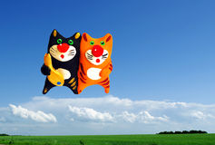 Two cats in the sky. With fish Stock Images
