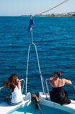 Two Caucasian brunette women on bow of yacht Royalty Free Stock Photography