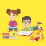 Two caucasian children doing homework together. Royalty Free Stock Photo
