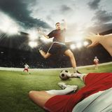Two men are playing soccer and they compete with each other stock photo