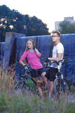 Two Caucasian Lovers With MTB Bicycles Outdoors. Royalty Free Stock Photos