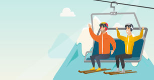 Two caucasian skiers using cableway at ski resort. Royalty Free Stock Photography