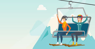 Two caucasian skiers using cableway at ski resort. Royalty Free Stock Photos