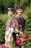 Two caucasian slavonic women  in the field of flowers Royalty Free Stock Images