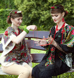 Two caucasian slavonic women sitting on the bench Royalty Free Stock Photos
