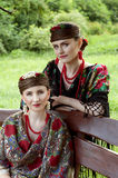 Two caucasian slavonic women sitting on the bench. Two caucasian slavonic women sitting on the wooden bench in the garden Stock Photo