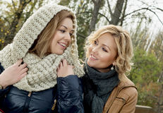 Two caucasian smiling woman in autumn outdoors Stock Photos