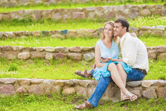 Two Caucasian Sweethearts Together Outdoors. Reading e-Book and Royalty Free Stock Photography