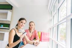 Two caucasian woman enjoy shopping online stock photography