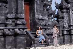 Two caucasian women in sunglasses near the balinese temple. Explore Indonesia, Bali. Royalty Free Stock Images