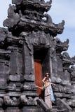 Two caucasian women in sunglasses near the balinese temple. Explore Indonesia, Bali. Stock Photo