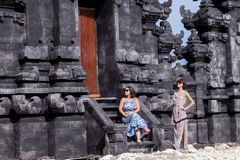 Two caucasian women in sunglasses near the balinese temple. Explore Indonesia, Bali. Stock Image