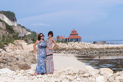 Two caucasian women in sunglasses near the balinese temple. Explore Indonesia, Bali. Royalty Free Stock Image