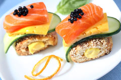 Two caviare and salmon sandwiches. With cheese Stock Photography