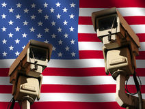 Two cctv cameras with flag Royalty Free Stock Photography