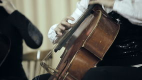 Two cellist playing fingers on cello at the concert stock video footage
