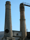 Two cement factory towers Royalty Free Stock Photography