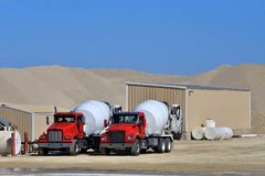 Two cement mixer trucks. Waiting to be loaded royalty free stock photos