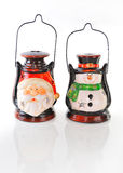 Two ceramic candlestick in the form of a snowman and Santa . Stock Image