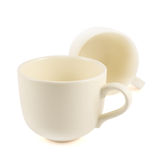 Two ceramic cream colored cups composition Royalty Free Stock Image