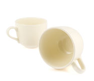 Two ceramic cream colored cups composition Stock Photos