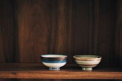Free Two Ceramic Cups On Wooden Shelve Royalty Free Stock Image - 182409336