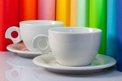 Two  ceramic cups and paper rolls Royalty Free Stock Photos