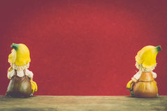 Two ceramic doll sit on wood Royalty Free Stock Photo