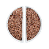 Two ceramic plates with flax seeds Stock Photos