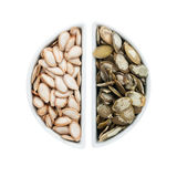 Two ceramic plates with pumpkin seeds Stock Images