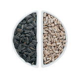 Two ceramic plates with sunflower seeds Stock Photo