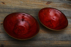 Two ceramic red empty bowls on a wooden Stock Image