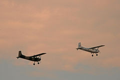 TWO CESSNAS. Two Cessna-185 aircraft airbone in the sky Royalty Free Stock Images