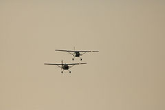 TWO CESSNAS IN THE SKY. Two Cessna-185 aircraft airbone in the sky Stock Photography